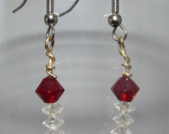 Red, pink and clear crystal Christmas tree-like designed beaded earring.