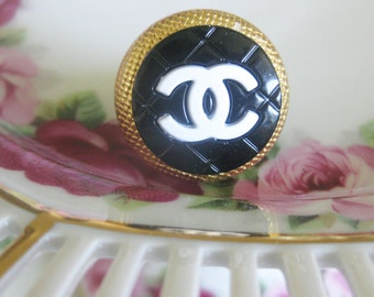 black white button ring