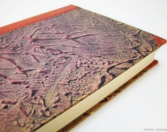 Upcycling secret diary notebook made from a vintage book