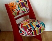 Unique red chair, upholstered with multicolour Otomi fabric.
