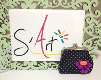 Polka dots coin purse with a cute design
