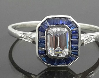 Emerald cut blue baguette sterling silver solitaire ring