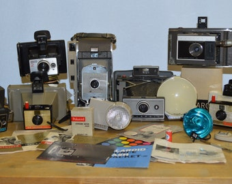 Large Lot of Vintage Polaroid Cameras with accessories with lots of paperwork.  Landcamera 800 J66 230 Big Swinger