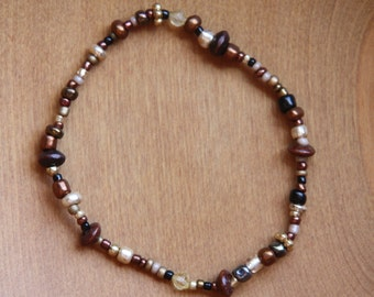 Beaded bracelet in earth tones with gold and copper