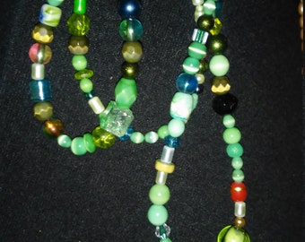 beautiful green beaded necklace with tear drop. center Piece