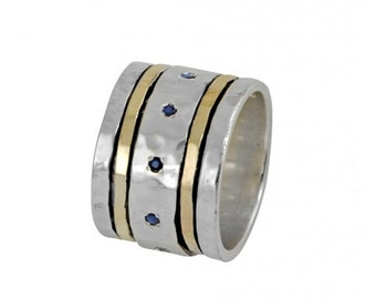 Silver and gold spinning ring with Sapphire