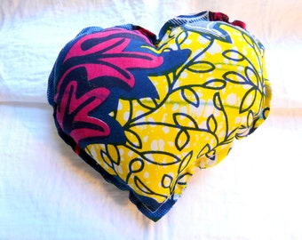 Small African Wax print fabric flowers to offer or afford heart cushion