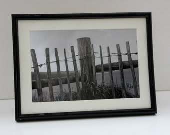 Fence along the coast: Framed photo
