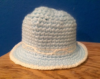 Blue and White Knit Baby Hat With Brim