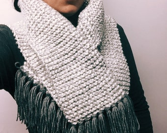White and gray handmade knitted chunky scarf.