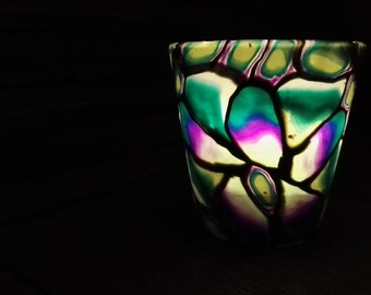 A polymer clay handmade votive candle holder with LED light, giving a spectacular colourful glow to your home.