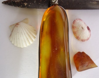 Mexican amber clear honey orange pendant set on sterling silver wire