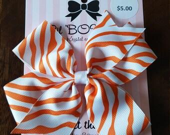 Animal print pinwheel bow