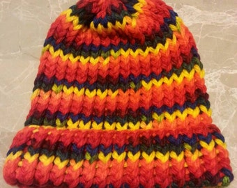 Child size rainbow colored knitted hat with brim