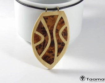 Maple de France pendant with veneers of ethnic patterns of the Morocco Thuja