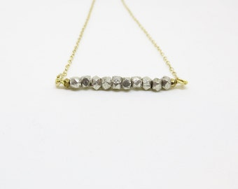 Silver and Brass Beaded Bar on Gold Chain