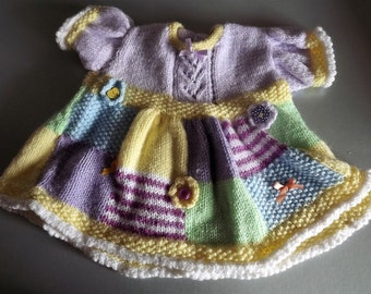 Patchwork hand knitted Dress in a rainbow of pretty pastel colours. 3-6 months.