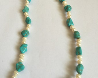 Blue stone with white pearl necklace