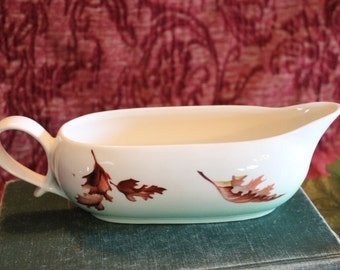 White and Green Ceramic Gravy Boat with Falling Leaves and Looped Handle