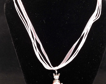 18 inch Pink Ribbon Necklace with silver color cat charm as pendant.