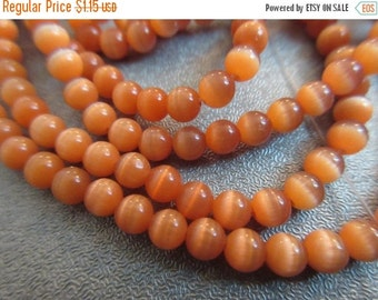 ON SALE Tangerine Cat's Eye Round 4mm Beads 105pcs