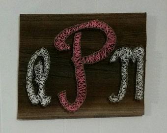 Custom handmade string art monogram on reclaimed Barnwood