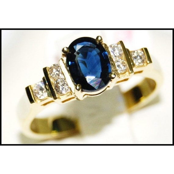 Diamond oval solitaire blue sapphire ring 18k yellow gold for Sapphire studios jewelry reviews