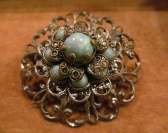 Vintage Brooch, gold-toned with green beads/stones