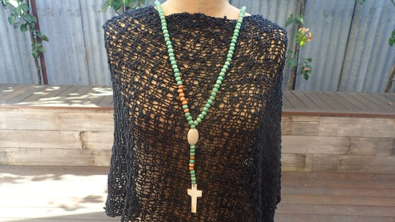 Hand crafted resin bead with cross