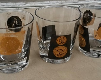 Set of 3 on the rocks glasses with american coin decoration. NO DAMAGE.
