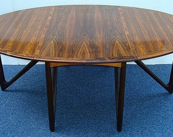 Wonderful quality Danish drop leaf dining table by Kurt Ostervig