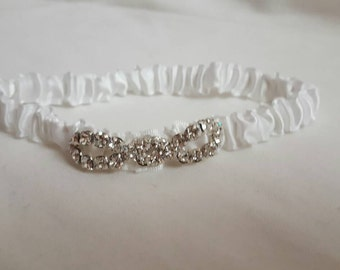White newnorn headband with rhinestones