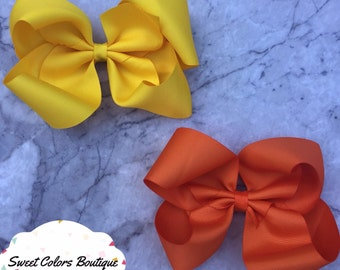 Set Of 2 Orange & Yellow Hair Bows