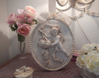 Plaster Medallion in the baroque style with decoration of Cherub skated to suspend