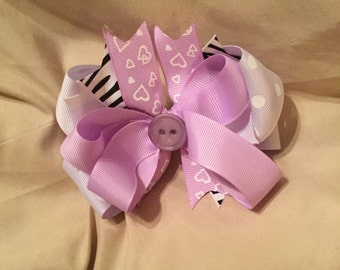 Purple and zebra hair bow