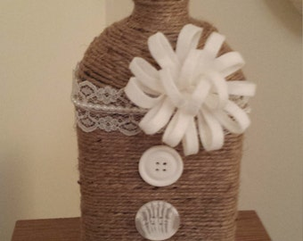 Jute wrapped recycled glass bottle