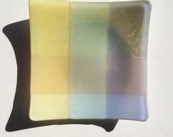 Green, yellow, blue and purple fused glass bowl