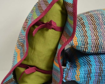 Handwoven cushion of linen. Weaving many-coloured and green lime. One of a kind and original weaving.