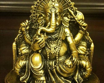 1 super lovely beautiful hand made/ hand carved/ hand painted candles in Lord Ganesh figurine/ statues in gold color. Home decoration