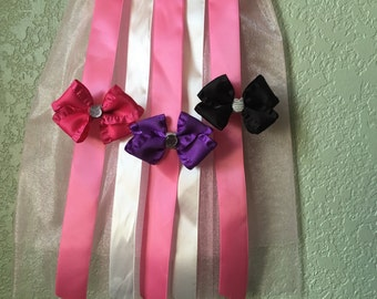 2.5 inch purple, pink and black bow with gemstone