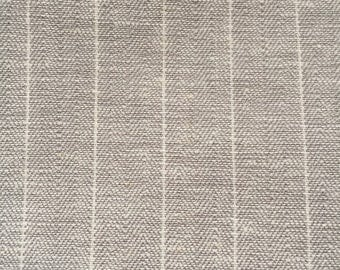 Cotton fabric has thin stripes.