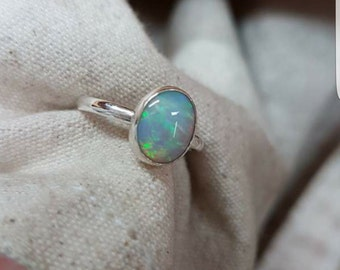 Sterling silver, Australian opal bezel set ring.