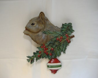 Hand painted wooden squirrel ornament.