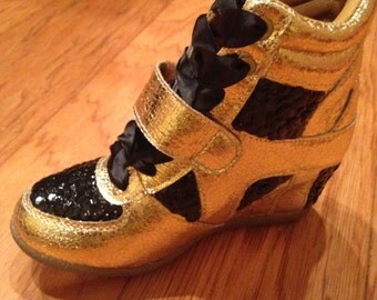gold wedges with black sequin embellishments