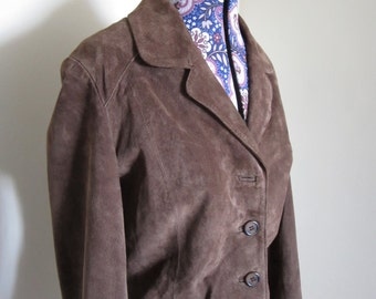 1990 suede silk lined jacket.Brown 4 button. two pockets WS Leather. label size 12