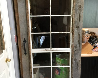 Hand made rustic door with vintage rollers