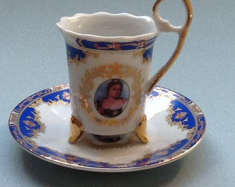 Vintage footed demitasse cup and saucer with portrait of a lady