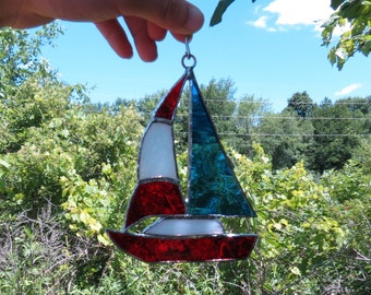 Stained glass sailboat with ring hanger