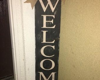 Welcome door sign with burlap bow