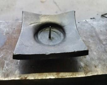 Forged bowl candel holder.
